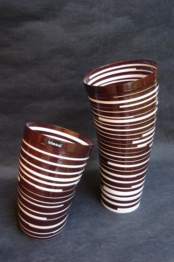brown and white rolled paper sculptural vases