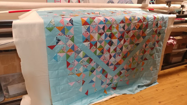 The Exploding Heart quilt loaded on my Gammill longarm