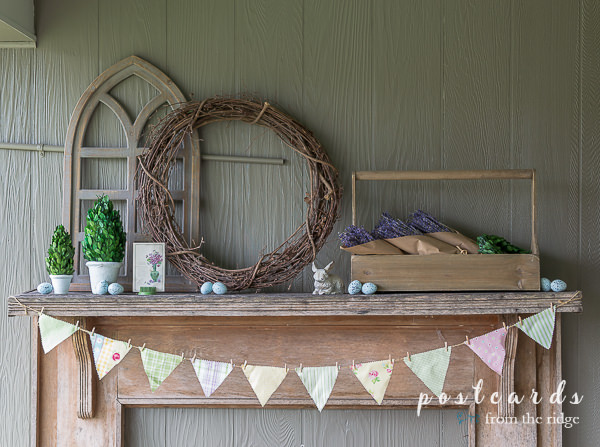 rustic spring mantel with fabric banner and cottage decor