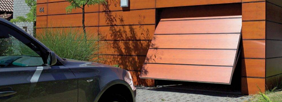 The hardwood hinged garage doors.