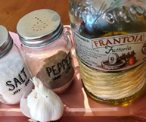 olive oil salt pepper and fresh garlic in the photo