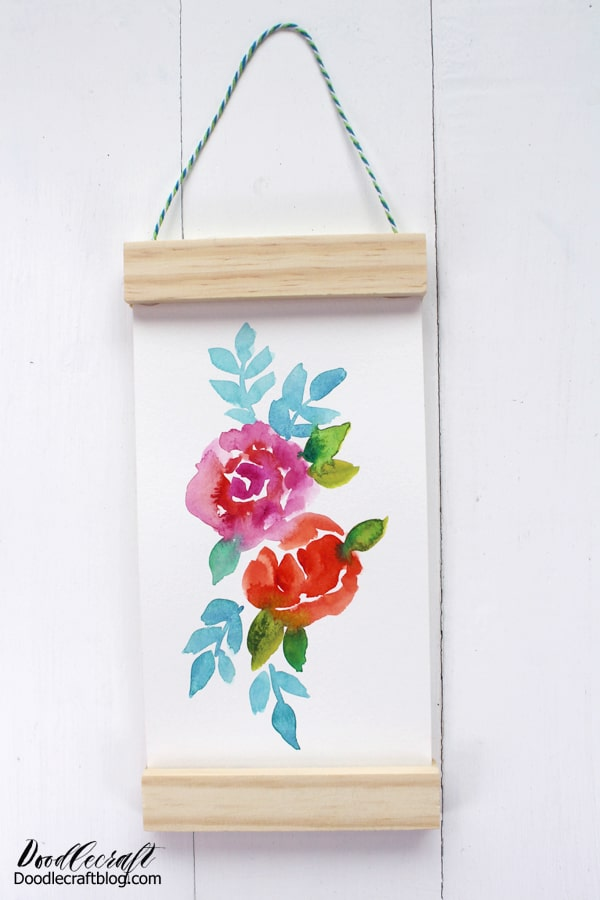 Make a hanging scroll from recycled materials. This elegant and simple painted floral scroll makes a great gift or gorgeous home decor. This great scroll-like technique works for any type of art--including the kids doodles.