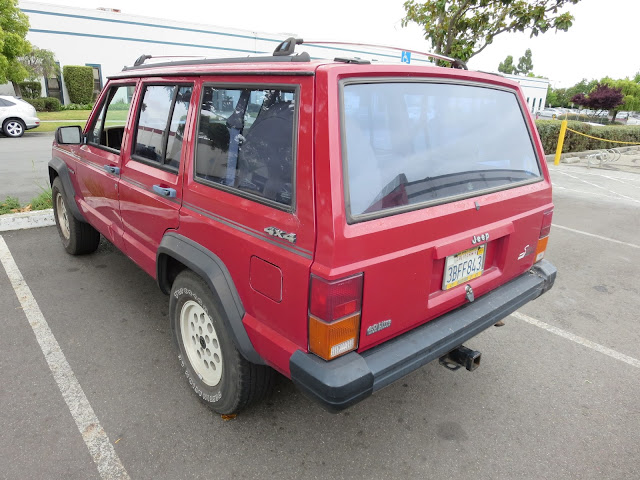Dents & peeling paint on Jeep Cherokee before repairs at Almost Everything Auto Body