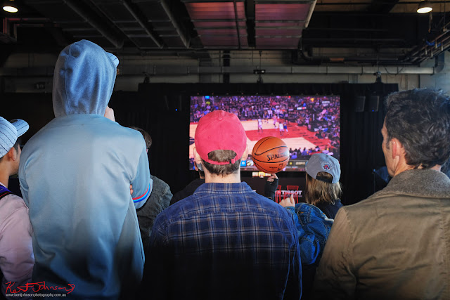Guests watching the big screen for the Raptors VS Warriors game at the TISSOT NBA Finals Party Sydney - Photography by Kent Johnson.