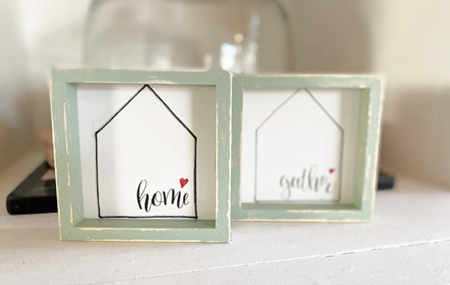 home and gather signs with green frames