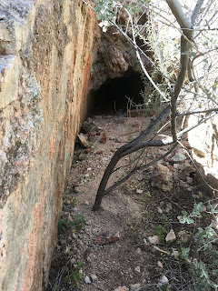 A narrow cut leads up to the main entrance of the Betty Lee Mine
