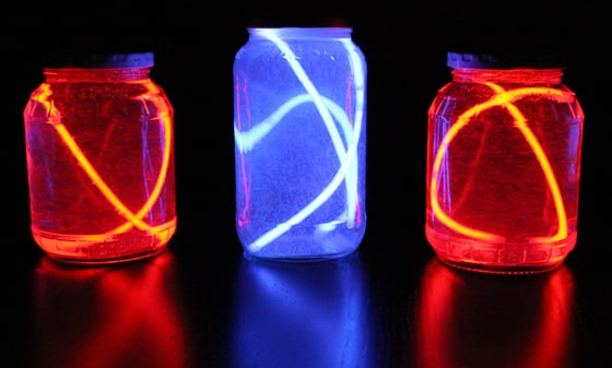 glow sticks turned into easy lanterns with recycled jars