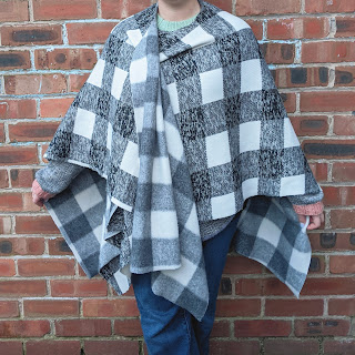 no sew shawl in black and white check worn draped and crossed over slightly at the front