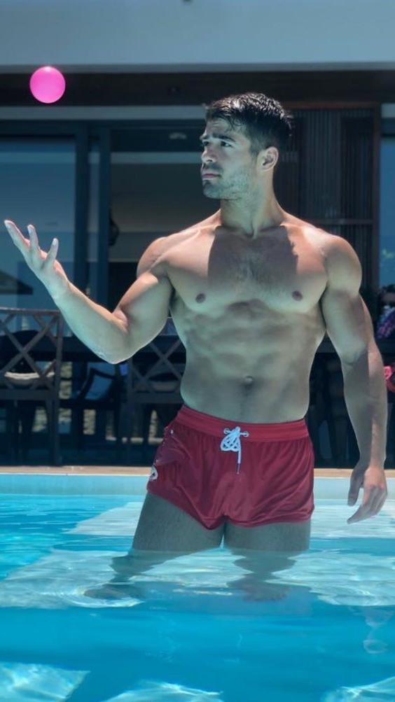 sexy-masculine-hairy-bare-chest-gay-top-dude-pool-fun-ball-play