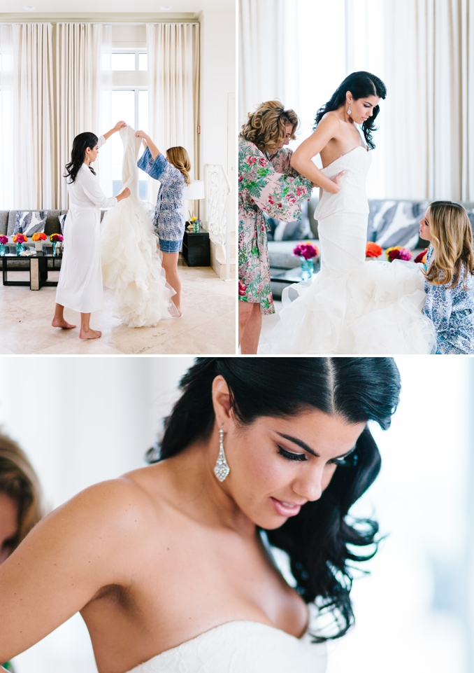 bride getting into her Vera Wang wedding dress