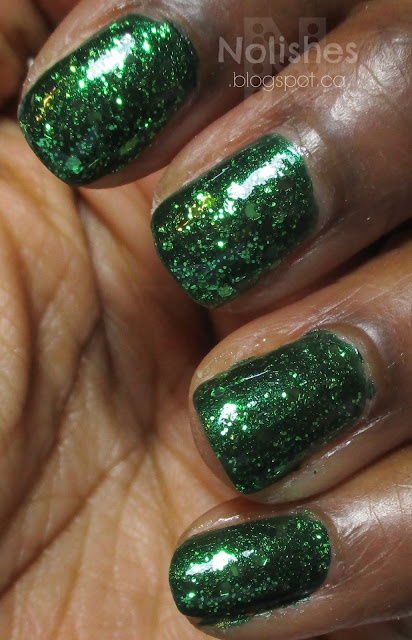 Deep Emerald Green Glitter Manicure using Nubar 'Greener' and L.A. Girl 'Purge', on dark skin