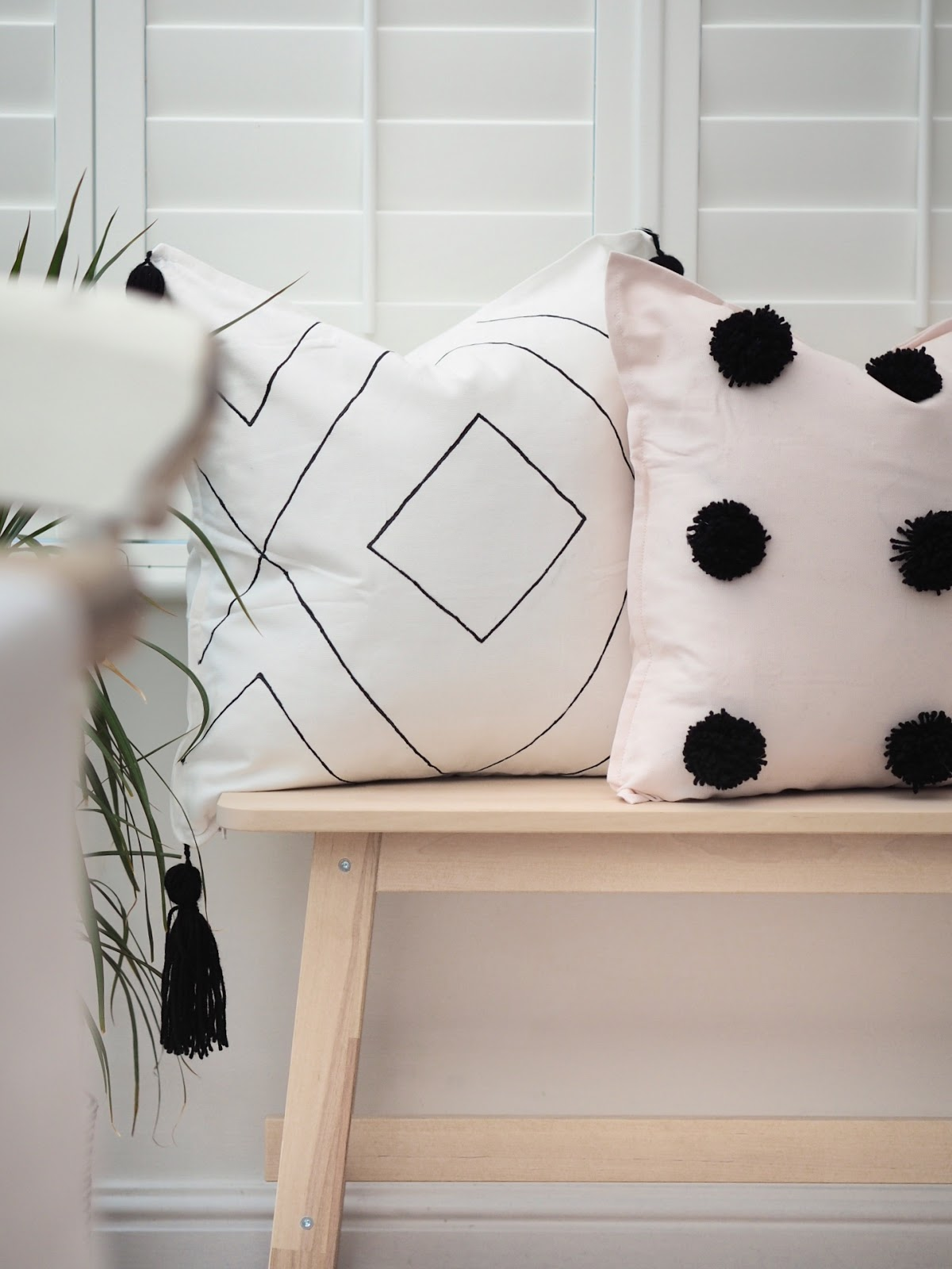 DIY tutorial boho cushion cover with woollen pom poms and tassels. Hand drawn and finished with fabric paint. DIY handmade home interiors to create luxury decor on a budget