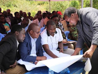 officials looking at maps for the Kimwarer Dam project