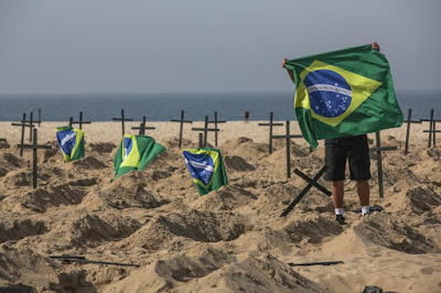 Some of the graves were flanked with Brazilian flags.