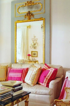 pink and gold cushions with antique mirror