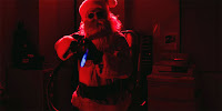 Santa with a flamethrower from silent night movie 2012