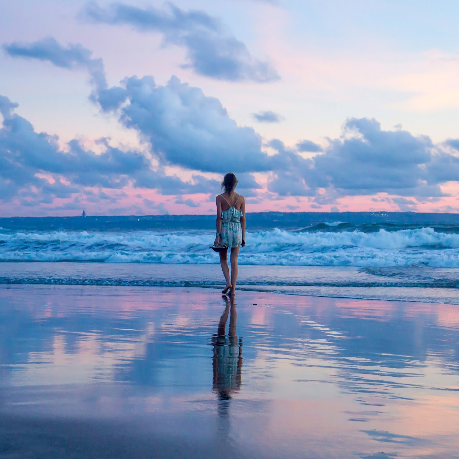 Fashion and Travel Blogger, Alison Hutchinson, walking on the beach at sunset in Canggu, Bali