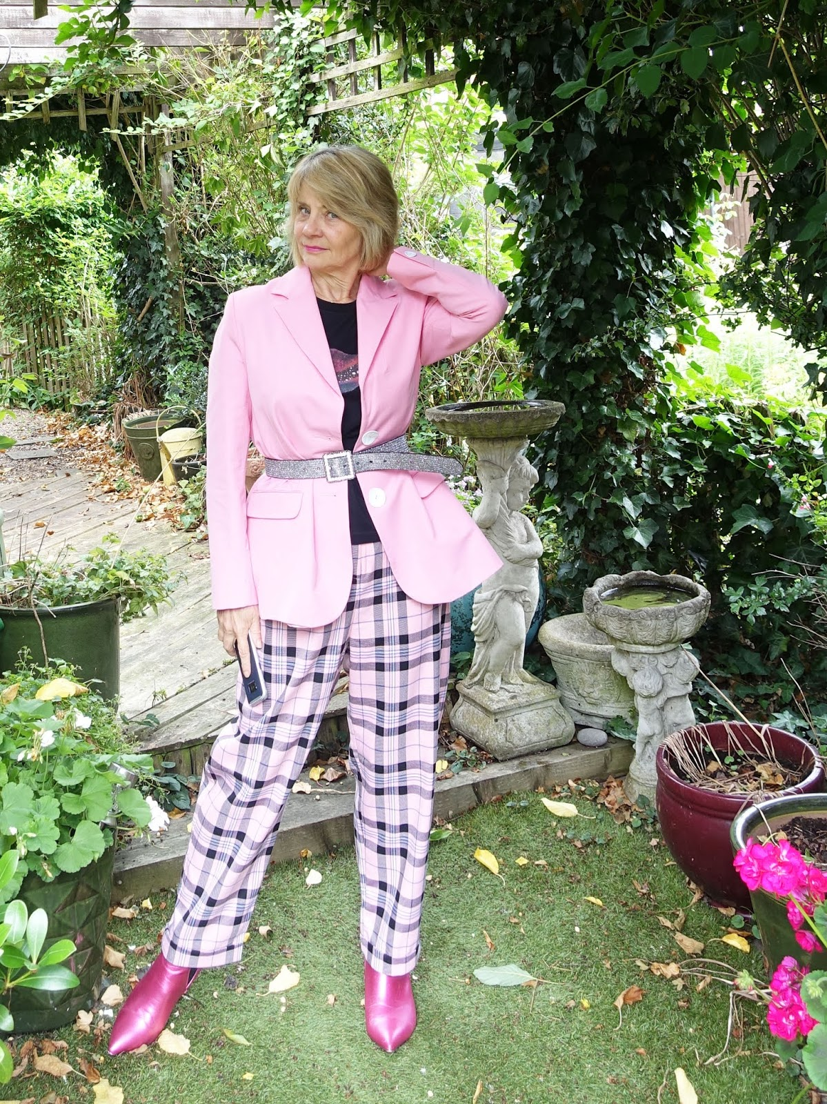 A colourful casual and smart outfit for any age - check trousers with ankle boots and belted oversize jacket worn by Gail Hanlon of Is This Mutton, the over-50s style blog