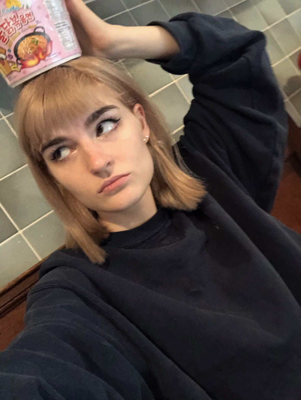 a photo of me after having my hair cut and coloured at Bleach- it was a long sandy blonde bob. I am also holding a cup noodle on top of my head