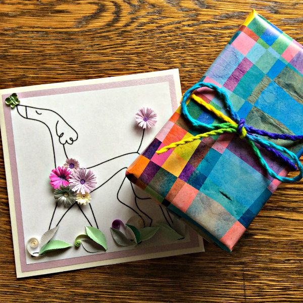 quilled dog card decorated with flowers with colorfully wrapped birthday gift
