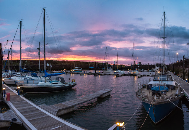 Photo of another view of the sunset over Maryport Marina