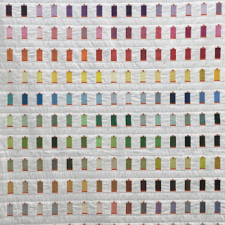 spools of Aurifil thread quilt