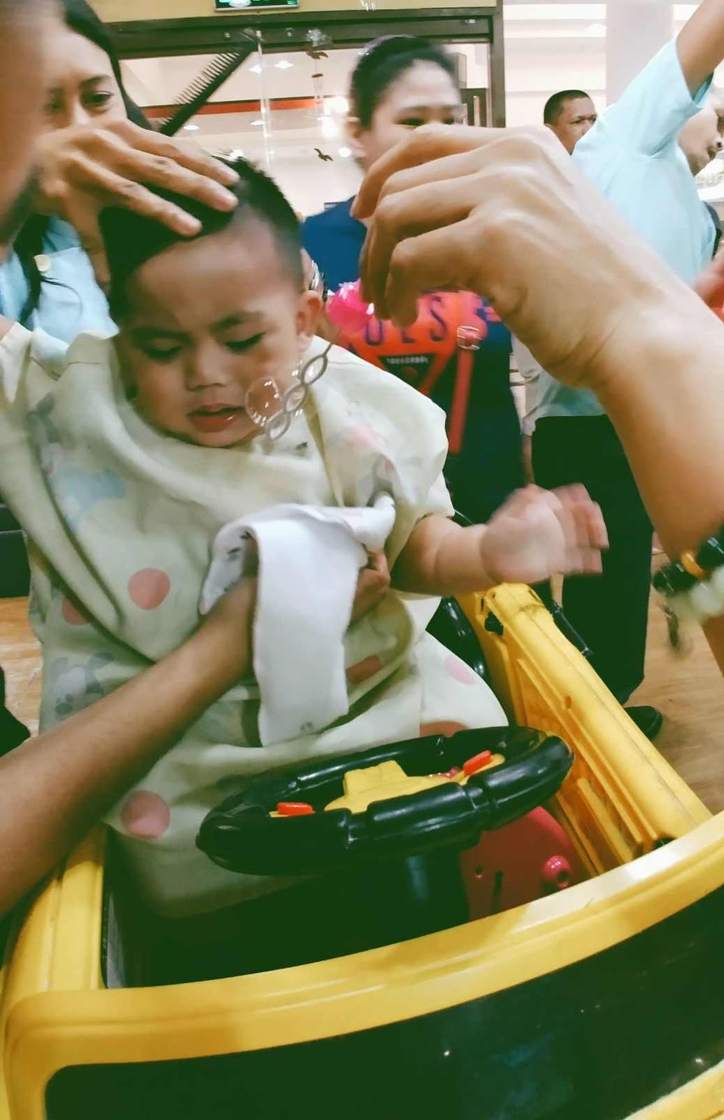 Miguel a bit agitated during his first haircut at Cuts 4 Tots