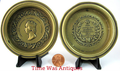 https://timewasantiques.net/products/queen-victoria-death-of-albert-1861-memorial-pair-of-brass-dishes-mourning