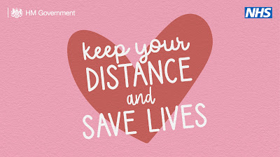 Keep your distance and save lives. Red heart on a pink background