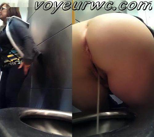 Hidden cam in public toilet films women peeing (Orange handrail toilet)
