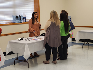 Students participating in a blood pressure measurement demonstration