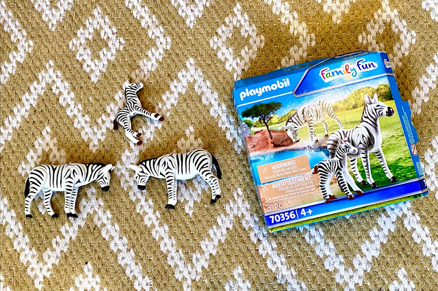 The playmobil zoo zebra box with 2 adult zebras and one foal