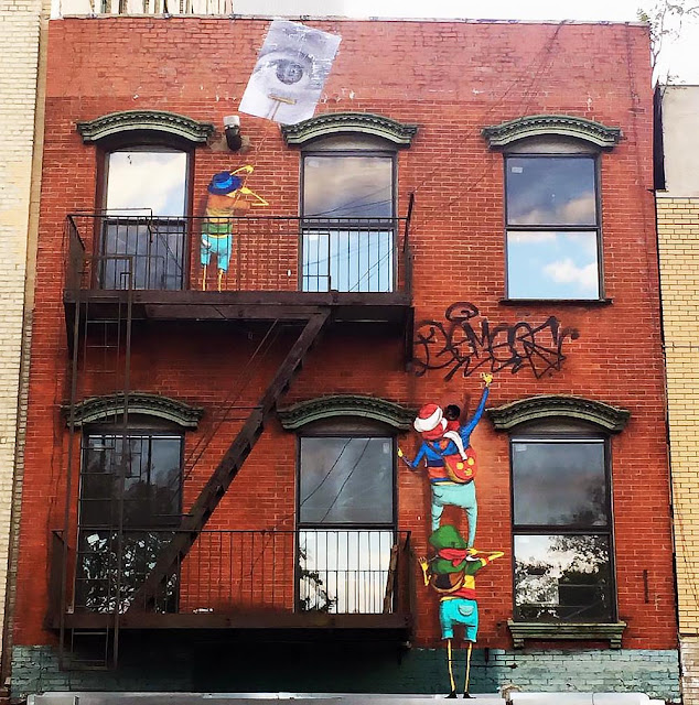 The Brazilian twins Os Gemeos just teamed up with JR for yet another new collaboration which just took place on the busy streets of New York City.