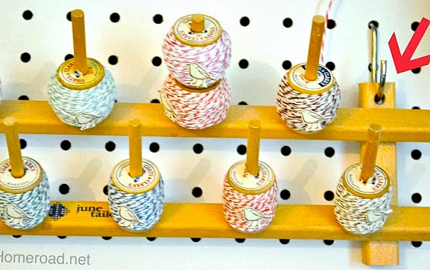 craft room organization for twine on a pegboard