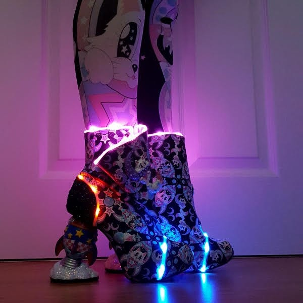 LED light up boots in dark with rocket shaped heel