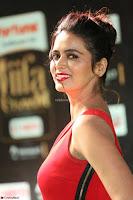 Meenakshi Dixit in Red One Shoulder Red Zipped up gown at IIFA Utsavam Award 31.JPG