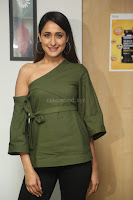 Pragya Jaiswal in a single Sleeves Off Shoulder Green Top Black Leggings promoting JJN Movie at Radio City 10.08.2017 073.JPG