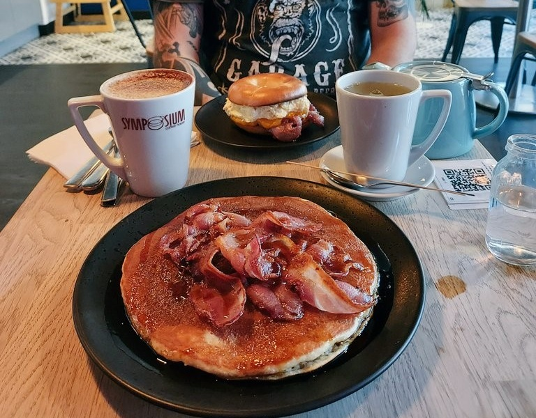 Bacon and maple syrup pancake and coffee at Symposium coffee house