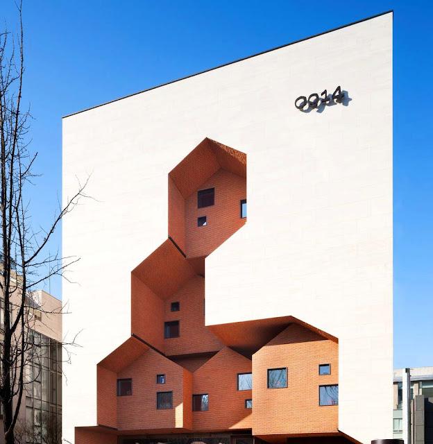 fachada exterior tienda simone detalles arquitectónicos contemporáneos