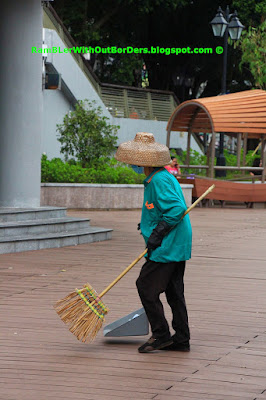 Janitor with the traditional Tanka hat, Aberdeen Promenade, Hong Kong