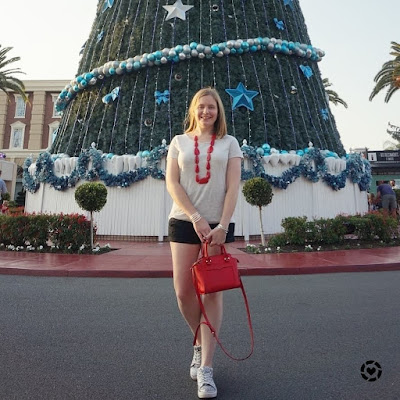 awayfromtheblue Instagram | movie world white christmas outfit foil star print tee denim shorts red accessories rebecca minkoff micro avery bag