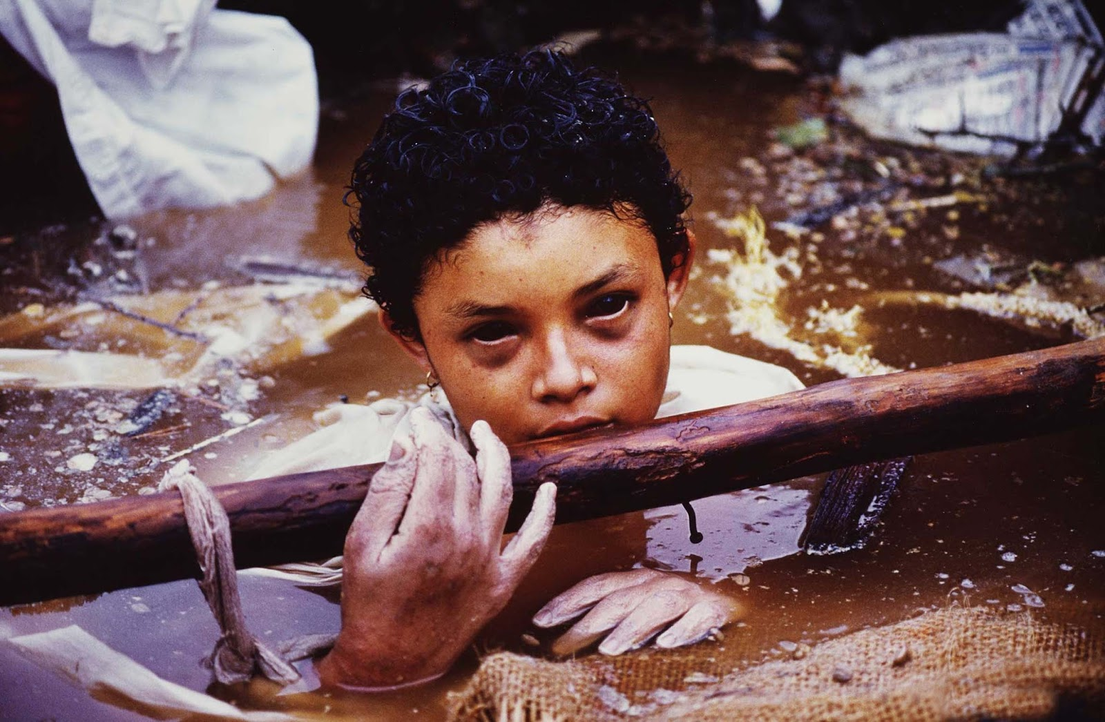 A victim of a Colombian volcano disaster, Omayra Sanchez was trapped in water and concrete for three days. This photo was taken shortly before she died.