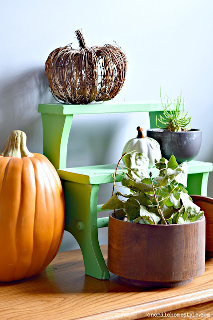 Rustic and natural fall decor on a vintage step-stool display