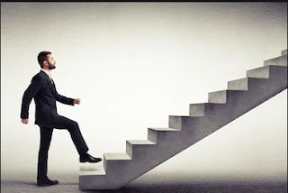 A man climbing Stairs to Success.