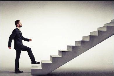 A man climbing staircase to Success.