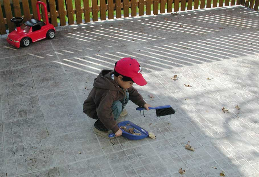 right childcare, kid sweeping
