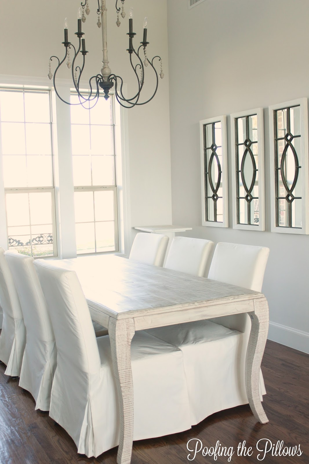 All white dining room needs color and texture.