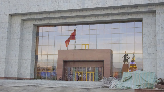 Big building right next to the big Bishkek flag and next to Ala-Toh Square