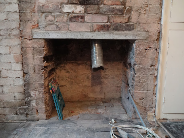 opened chimney ready for log burner
