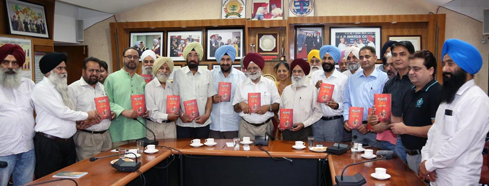 "PAU VC Dr Baldev Singh Dhillon and Punjab Arts Council Chairman Dr Surjit Patar with others releaseing Prof Gurbhajan Gill's New Book ""Sandhoor Dani"""